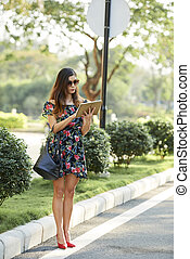 Woman using app on digital tablet