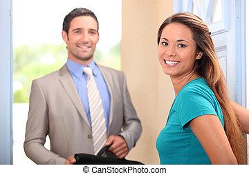 Woman welcoming her husband home