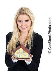 woman with house in hand