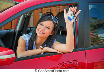 Young Woman with a new car and car keys