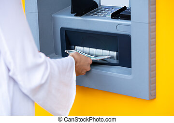 Woman's Hand Withdrawing The Cash From ATM