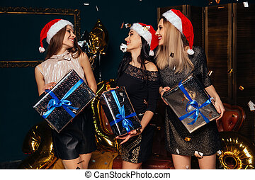 Women with Christmas gifts in hands