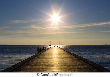 Wood bridge to the sea at sunset beach in island Koh Samui, Thailand