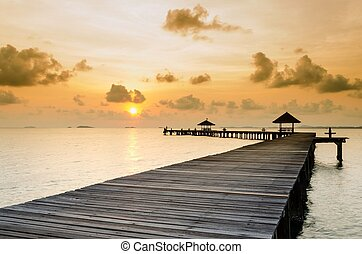 Wood jetty on the Beach and tropical sea, East of Thailand.