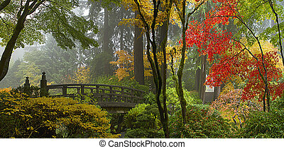 Wooden Bridge at Portland Japanese Garden in Fall One Foggy Morning Panorama
