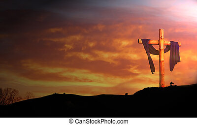 wooden cross against sunrise clouds