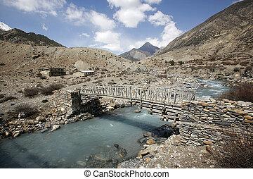 Wooden footbridge on the annapurna circuit, nepal