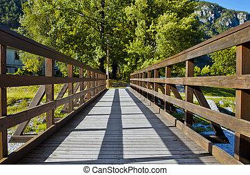 Sunny wooden footbridge
