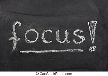 word focus with an exclamation mark handwritten with white chalk on a blackboard