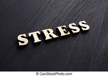 Word Stress from wooden letters on a desk.