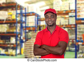 Worker man with red uniform in his workplace