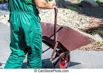 Worker with a wheelbarrow