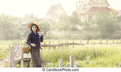 Working woman in countryside, Thailand