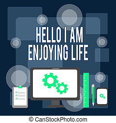 Writing note showing Hello I Am Enjoying Life. Business photo showcasing Happy relaxed lifestyle Enjoy simple things Business Concept PC Monitor Mobile Device Clipboard Ruler Ballpoint Pen.