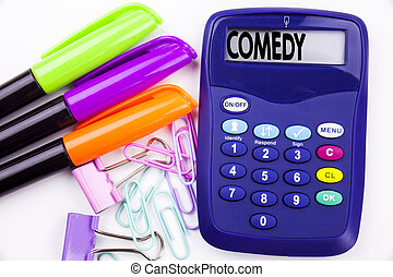 Writing word Comedy text in the office with surroundings such as marker, pen writing on calculator. Business concept for Stand Up Comedy Microphone white background with space