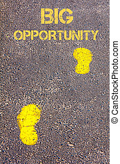 Yellow footsteps on sidewalk towards Big Opportunity message