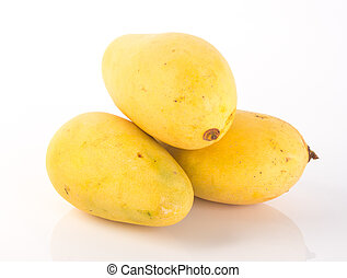 yellow mango fruit on a background