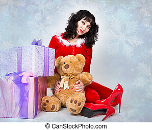 young and beautiful woman in red coat holding a nice Christmas present box