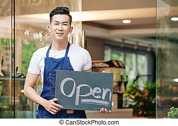 Young Asian cafe owner
