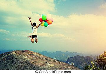 young asian woman jumping
