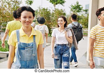 Young Asian woman walking outdoors