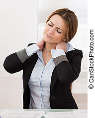 Young Attractive Businesswoman Suffer From Neck Pain