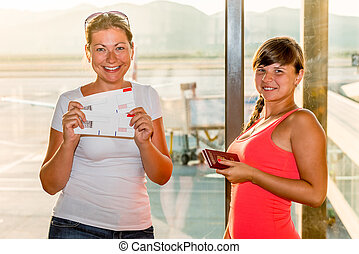 young beautiful girl with forms boarding passes
