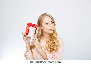 young blond woman with present box.