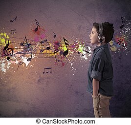 Concept of young boy listening to music