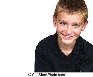 young boy smiling - wearing a black shirt