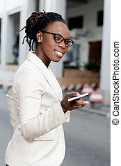 Young business woman with a credit card