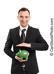 Young businessman with a piggy bank