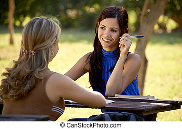 Young college students talking and studying for university exam