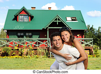 Young couple and their house