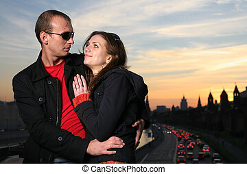 Young couple in Moscow city at sunset