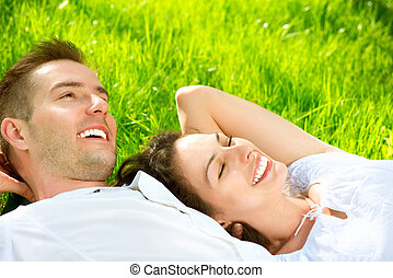 Young Couple Lying on Grass Outdoor