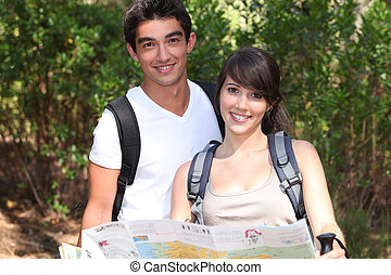 Young couple orienteering