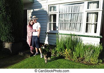Young Couple Outside House