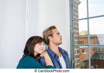 Young couple sharing a quiet moment at home