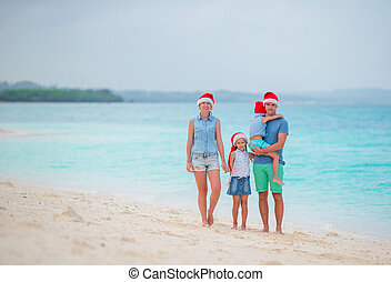 Young family with kids on tropical Christmas vacation