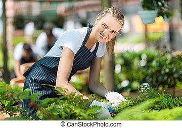 female nursery worker working