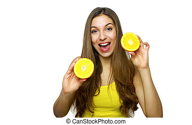 Young happy woman holding oranges