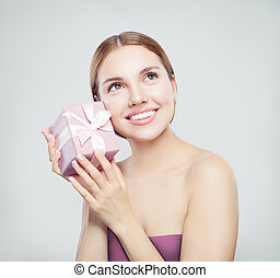 Young happy woman with present