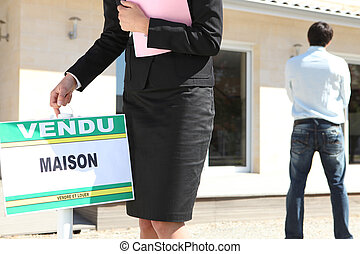 young man buying a house