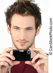 Young man with a digital camera
