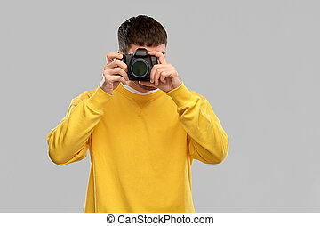 young man with digital camera