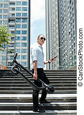 Young man with scooter