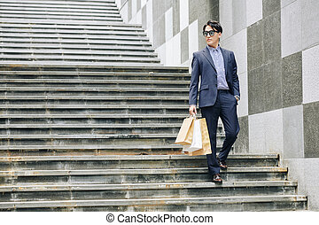 Young man with shoping-bags