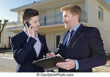 young successful man with a real estate agent
