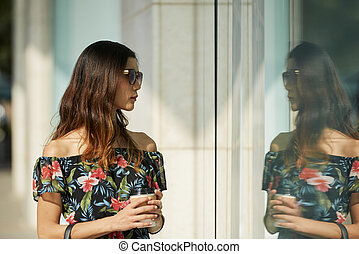 Young woman at store window